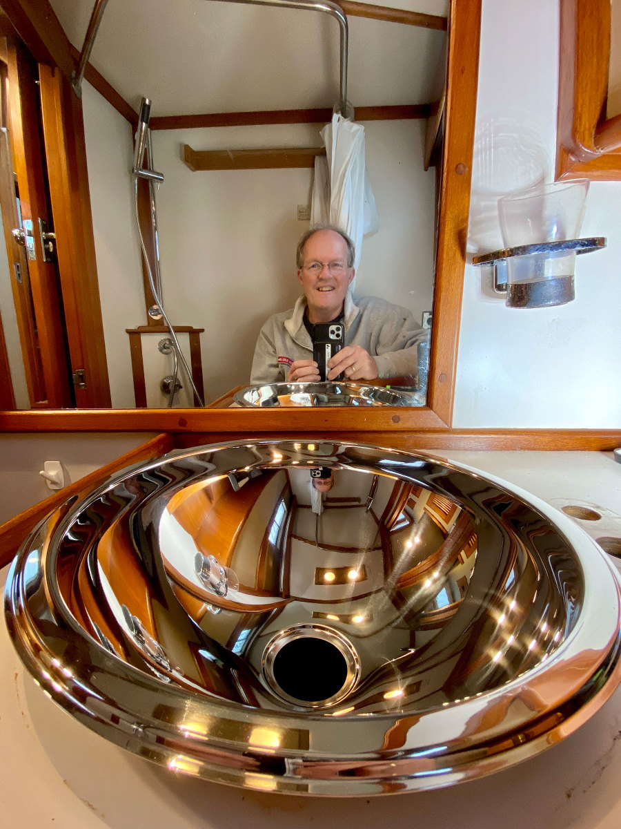 Left: Because he had to remove the sink to replace the faucet in the head, Onne also replaced the tarnished basin.