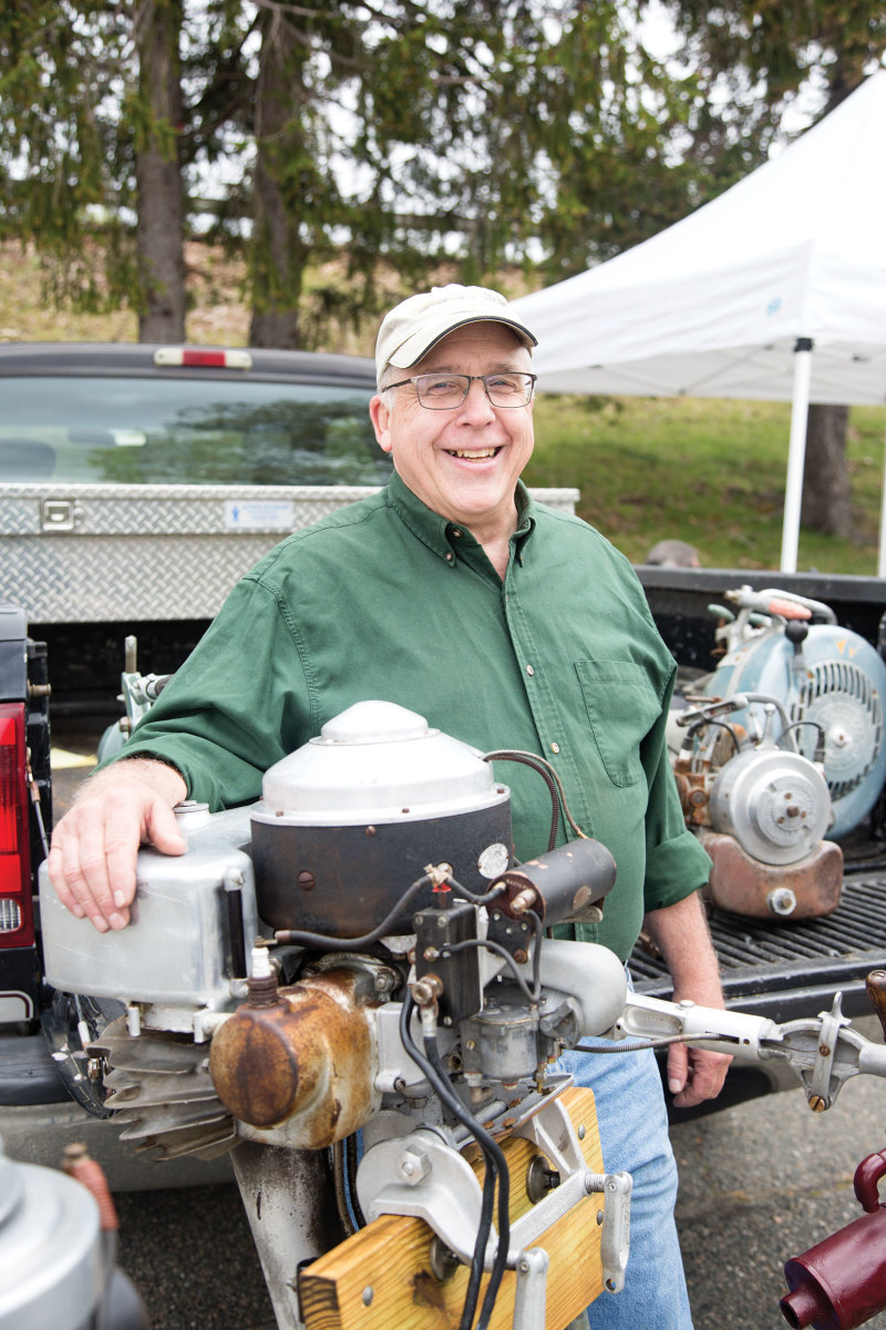 """Gary Mower with an 11-hp Lockwood """"Chief"""" outboard with electric starter."""