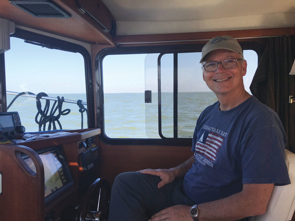 John Gray at the helm of his Kadey-Krogen 39, on which he has traveled through the Inside Passage andSalish Sea.