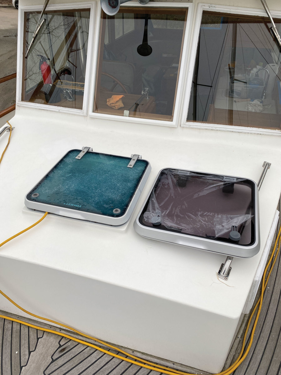 The new hatch sits next to the old one just before installation.