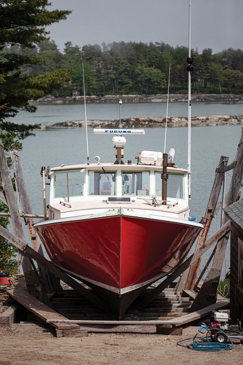 A 42-foot Peter Kass lobsterboat awaits a new bootstripe on the marine railway at John's Bay Boat Company in South Bristol.