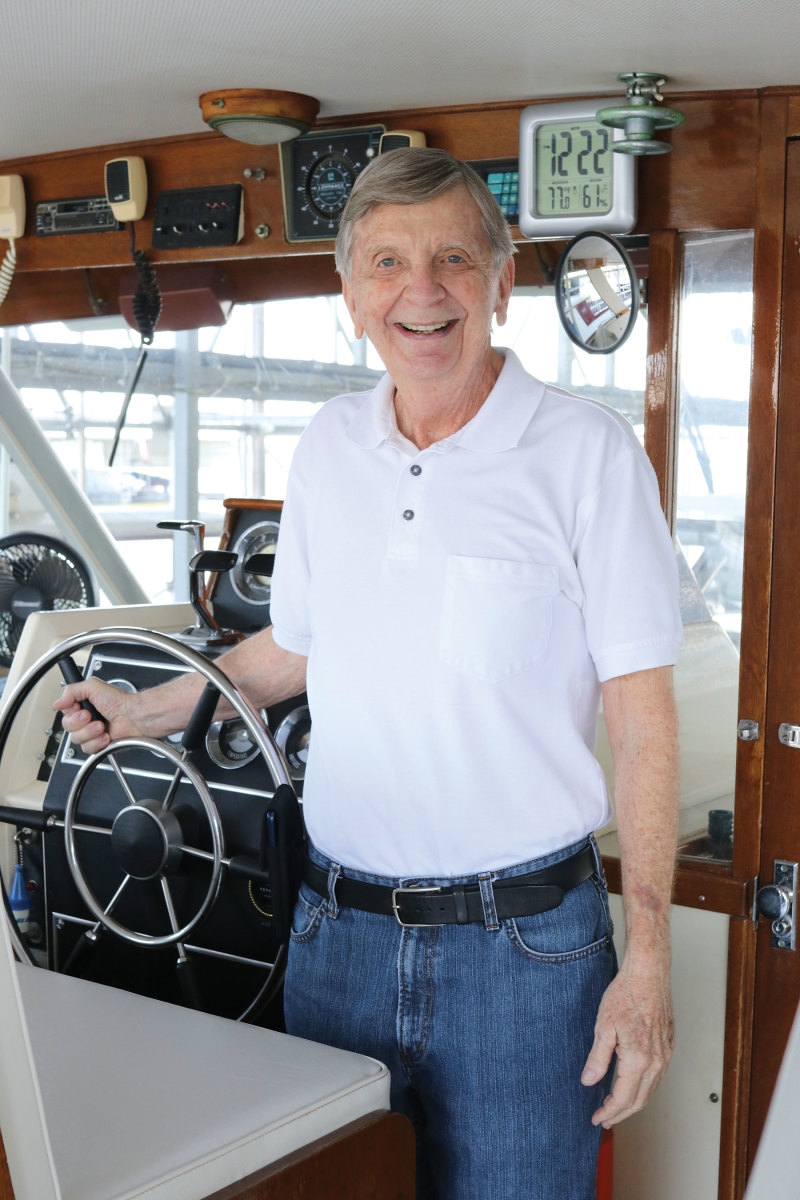 Bob Crouch at the bridgedeck of his Chris-Craft Commander, Lady's Choice.